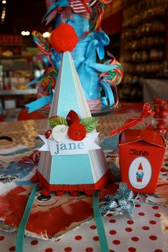 Beautiful blue party hat with a red pompon, decorated with flowers and the little girl's name! NieNie Dialogues: Jane turns seven.