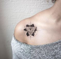 Abstract lotus flower tattoo on shoulder by Hongdam