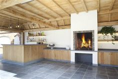 High Fire | Fireplace | Bourgondisch Kruis - Rustieke bouwmaterialen - Realisaties - Poolhouse Pool House Designs, Pole Barn Homes, Mountain Homes, Pool Houses, Home Renovation, Outdoor Living, Sweet Home, New Homes, Home And Garden
