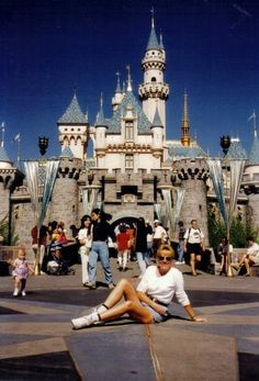 """Pretty sure I created the """"I'm just relaxing in front of the castle at Disneyland"""" pose. Maude at Disneyland, 1993.  Follow Maude and Hermione on Pinterest for more fun and Pinspiration!"""
