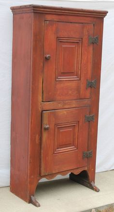 """desirable form 18thC New England pine 2 door shoe ft cupboard in old red paint - 65 1/2"""" tall x 32"""" wide x 16"""" deep"""
