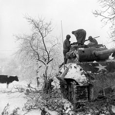 American soldiers aboard a tank in a snow-covered Ardennes field, Battle of the Bulge, December 1944.   Read more: 'Fury' in the Real World: Photos of Tank Warfare in World War II | LIFE.com http://life.time.com/history/fury-reality-of-tank-warfare-wwii-photos/#ixzz3HHQHZBut