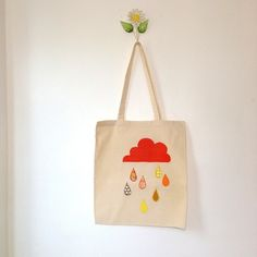 SALE OFF This funky and colourful bag will cheer you up even on the most gloomy day! Bright orange on cream colour way. Bag is cotton, the design has been machine embroidered with various colours of cotton. Gloomy Day, Sari Fabric, Cheer You Up, Orange Bag, Liberty Print, My Bags, Reusable Tote Bags, Clouds, Natural