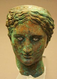 A Greek Late Hellenistic Bronze Head of a Woman with Inlaid Eyes. Ca. 150-100 B.C., from Mersin (Zephyrion), Cilicia, Asia Minor. British Museum, London