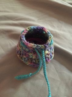 Crochet drawstring earbud holder keeps them from tangling with everything at the bottom of your purse or backpack.