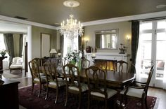 Large Formal Dining Area With White Fireplace On The Long Wall Room