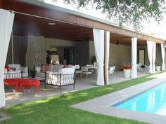 Ipe wood covered patio with limestone floor and pool coping