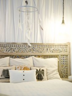 Step into an Artist's Airy Retreat // Headboard and dreamcatcher