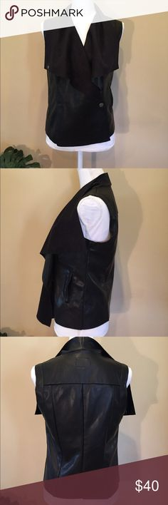 """Vegan Leather Biker Moto Vest Kut from the Kloth New without tags: Versatile faux black leather/suede vest. Wear it open with long bat wing lapels, snap it up motocross style. Snap it across and open. So great for layering. Looks and feels like real leather with suede-like interior. Hidden side pockets. Size small, 18"""" across, 23"""" front length, 21"""" back length. This vest is gorgeous! Kut from the Kloth Jackets & Coats Vests"""