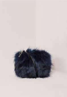This fierce and fluffy clutch is a show stopping piece. a0d236174fb52
