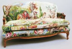 miniature sofa upholstered in antique petit point