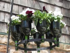 A handmade upside down wine bottle chandelier rack of recycled French wine bottles. This chandelier can become a planter or an ornamental piece to suit any occasion or any season.1000186_0_8-0939-outdoor-planters
