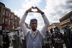 A man makes a heart shape with his hands during a protest near the CVS pharmacy that was set on fire yesterday during rioting after the funeral of Freddie Gray, on April 2015 in Baltimore,. Get premium, high resolution news photos at Getty Images Baltimore Riots, Baltimore Police, Baltimore Maryland, Funeral, Powerful Pictures, Amazing Pictures, Police Call, Pictures Of The Week, Afro Punk