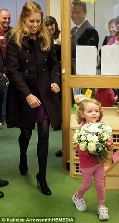 Princess Beatrice is given a bunch of flowers by six year old Rebecca Cullen as she visits the Royal Hospital for Sick Children (Sick Kids) in Edinburgh