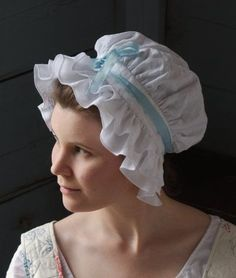 """18th century linen caps: The """"mob cap"""", or the Corday, was a linen cap that was similar to a bonnet and made of linen(usually white). These caps were named after Charlotte Corday who was a part of the radical group and working class, and murdered Marat in his own bathtub."""