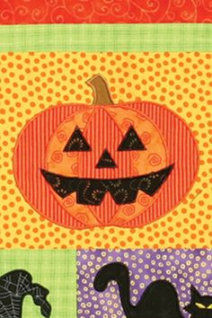 close up, Halloween Fun quilt, machine embroidered jack-o-lantern