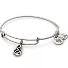 The Sweet Melody Charm Bangle is available in a Rafaelian Gold and a Rafaelian Silver finish. Alex and Ani's Expandable Wire Bracelet allows the the wearer to adjust the Bracelet for a perfect fit.