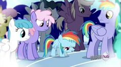 We finally get to see Rainbow Dash's family with her dad on the right and possibly her mother to her left, since they both have purple/pink eyes.