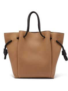 Shop this month's womenswear deliveries from MATCHESFASHION. Luxury Designer clothes, shoes, bags and accessories from designer brands including DVF, Christian Louboutin and Alexander McQueen. Gold Leather, Leather Boots, Leather Bag, Leather Jewelry, Leather Craft, Leather Tutorial, Loewe Bag, Bags Uk, Luxury Handbags