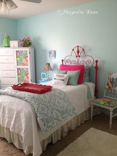 Spray painted vintage iron headboard in an adorable aqua and hot pink girl's room