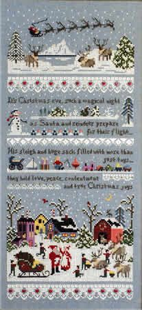 """Santas Village Sampler is third in the Village Series by The Victoria Sampler. """"Its Christmas eve, such a magical night As Santa and reindeer prepare for their flight... His sleigh and huge sack filled with more than just toys... They hold love, peace, contentment, and true Christmas joys."""" The model is stitched on 28-count Misty Blue 28-count Cashel (substitute 3270-564). The threads are available in a two thread packs - Silk Mori (610-920-0121W) and fibers, beads, and red hearts…"""