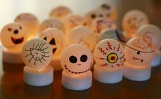 cute Halloween idea...ping pong balls and battery powered tea lights... ummmm so simple and super cool!