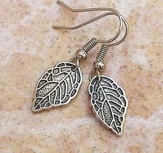 Hey, I found this really awesome Etsy listing at https://www.etsy.com/listing/177412978/leaf-metal-silver-charm-earrings-casual