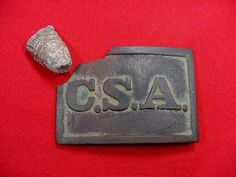 A super rare, excavated, solid cast brass, rectangle C.S.A. waist belt plate. This buckle was recovered on private property by Paul Kennedy in 1972. Paul recovered the plate from the position of Forrest's Cavalry along Old Town Creek at the Battle of Tupelo, Mississippi. The buckle has been bullet struck with the bullet passing from the front to rear, clipping off the upper left corner of the plate and folding the edge of the plate to the rear where the bullet passed, and also at the same...