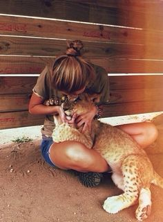 If I could I would have a pet lion, cheetah, leapord, cougar, or tiger