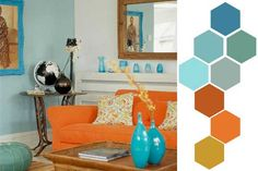 turquoise and orange living room. I don't think I would do the orange couch, but I did buy some orange and beige striped fabric to make curtains and pillows. Now, for some turquoise vases...