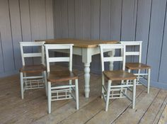 Plank Top Farmhouse Table With Painted Chairs