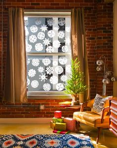 Let It Snow: 15 Ways to Decorate With Paper Snowflakes via Brit + Co.