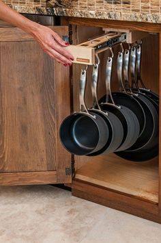 Love this organizational idea for pots and pans; since there's nowhere to put a pot rack at the new house!