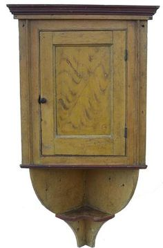 Late 18th. Century York Co., Pennsylvania Hanging Corner Cupboard...with an extending tail with shelf & original mustard and red paint,  circa 1780 - 1790.