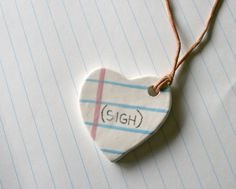 How great are these! Necklaces inspired by doodling in the margins of your notebook paper in school.