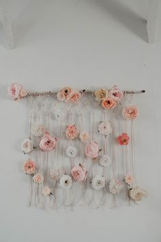 simple floral macrame wall hanging adorned with white and pink flowers