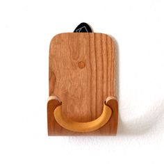 Hang your guitar or ukulele on the wall with one of our molded plywood guitar hooks. Walnut, Oak, Teak or Cherry. Guitar Wall Hanger, Guitar Hooks, Guitar Accessories, Home Accessories, Hollow Wall Anchors, Ukelele, Guitar Neck, Saddle Leather, Wood Surface