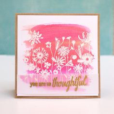 CardConcept4 Watercolor paper brushed with 3 colors of distress ink (ripe persimmon, picked raspberry and worn lipstick) on craft mat. Embossed in white with Hero Arts Blooming Meadow stamp when dry.