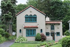 i think this is more traditional than Spanish Eclectic, but anyway, i like the turquoise with the taupe/gray/beige stucco color + the terra cotta roof tiles. It has the stucco surrounding the windows with the brick sill like we were talking about.