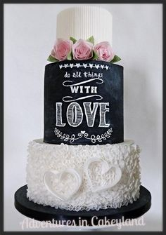 I used wafer paper for the bottom tier and roses, with a chalkboard effect with handpainting on the middle tier.