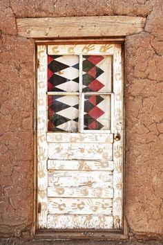 Decorated Door and Adobe Building