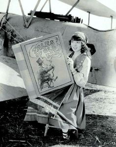 Colleen Moore and her gigantic book, ca. 1920's.