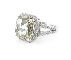 A Platinum and Radiant Cut Diamond Halo Ring