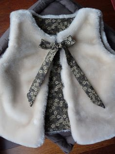 A beautiful and warm vest with MItsi Gray print