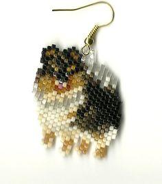 "A pair of hand beaded Black & Tan Pomeranian dog dangle earings. 1 & 3/8 "" long #DropDangle"