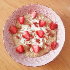Strawberry oatmeal with goji berries, coconutchips, and strawberries.