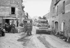 Sherman tanks passing through Reviers, 11 June 1944.