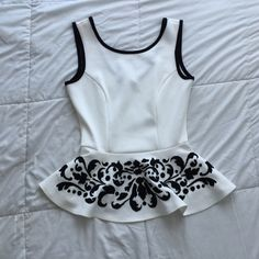 ✨White peplum top W/ Black accent embellishments✨ Brand new never used / SIZE SMALL / white & black / peplum top / true to size / feel free to ask questions / NO TRADES / offers are to be discussed via submit offer button only / ships within two business days M-F / NO LOWBALLING/ NOT BRANDY MELVILLE BRAND Brandy Melville Tops Blouses
