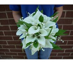 A hand tied spring bouquet of all white mini callas and lily of the valley.