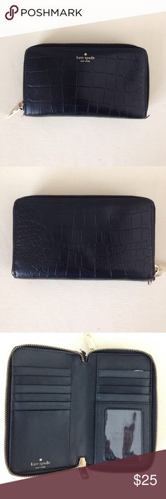 Kate Spade Black Leather Wallet Kate Spade New York Black Leather Wallet. Gold tone hardware. Double zippered for 2 compartment areas. 10 card slots, zipped coin pouch. Missing wrist strap, small tear on top right card slot, otherwise great condition. kate spade Bags Wallets